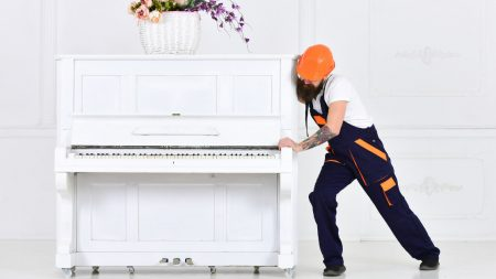 Man moving a piano